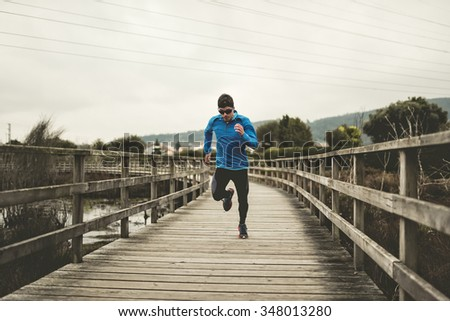 Runner man running very fast during a training session - stock photo