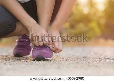 Runner prepare shoes for running. Vintage filter - stock photo