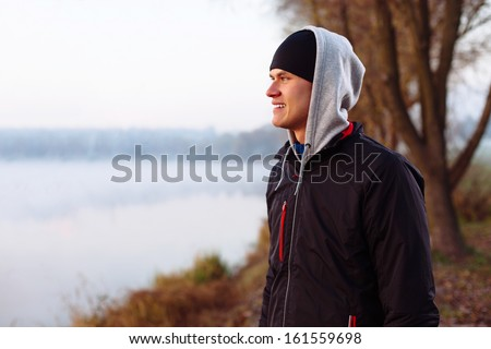 Runner resting after cold autumn run - stock photo