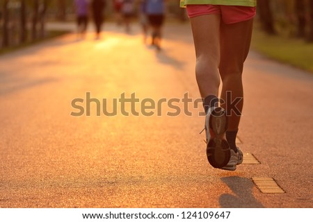 Runner running in the light of evening