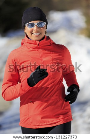Runner, spring running, exercise woman. Jogging on early spring in mountains. Healthy lifestyle, active woman concept. - stock photo