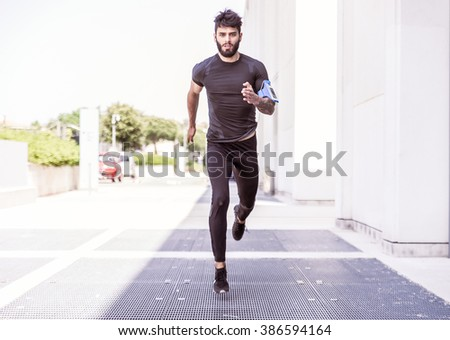 Runner training outdoors on a beautiful day - stock photo