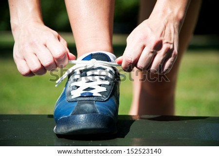Runner trying running shoes getting ready for jogging  - stock photo