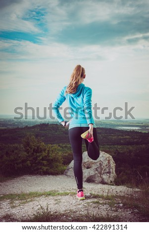 Runner Warming Up Before Running, watching landscape