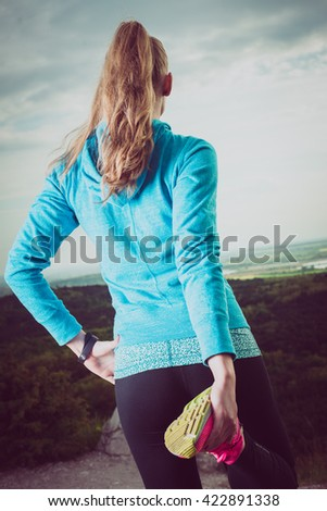 Runner Warming Up Before Running, watching landscape - stock photo