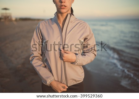 Runner woman jogging as part of healthy lifestyle.Fitness woman training and working out.Running at sunset on beach,sprinting for success goals.Amazing seaside landscape.Dedication and determination - stock photo