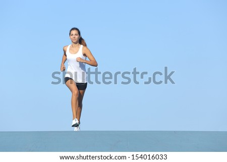 Runner woman running alone with the horizon in the background