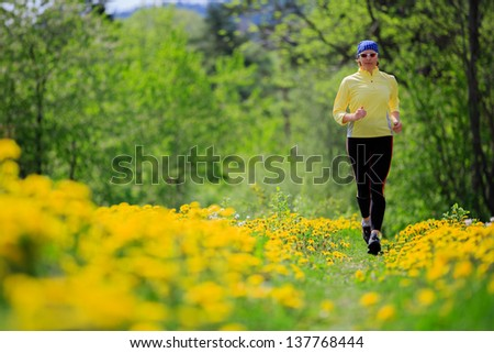Runner - woman running outdoors, training, weight loss concept - stock photo