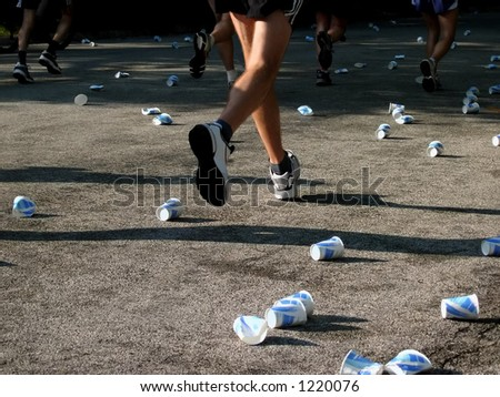 Runners at a water station - stock photo
