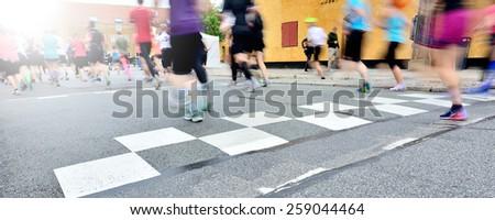 Runners crossing start or finish line - stock photo
