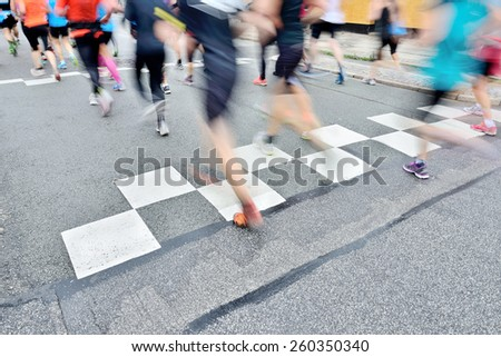 Runners crossing start or finish line - stock photo