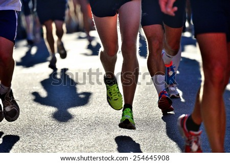 Runners in bright light - stock photo