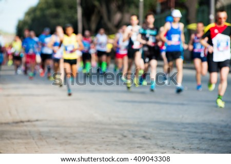 runners in marathon abstract, blurry - stock photo