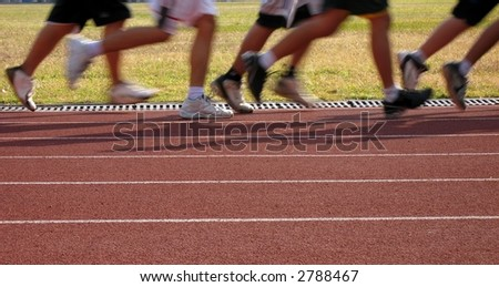 Runners in Motion -- exercising on an outdoor athletic running track