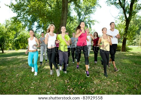 runners, jogging group in park - stock photo
