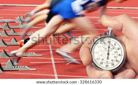 runners lined up ready to race, Historic stop watch time measurement - stock photo