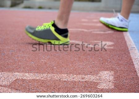 runners reaching the finish line - stock photo
