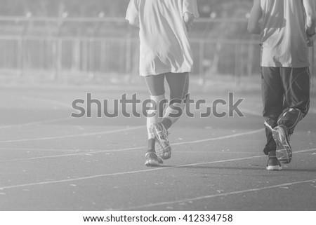 Runners running on Running track , black and white. - stock photo