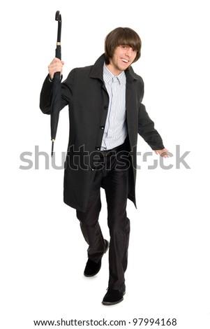Running a joyful young man in a raincoat. - stock photo