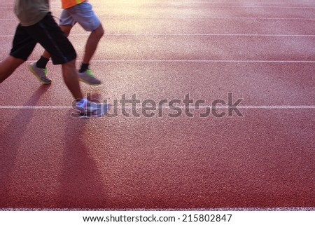 Running athlete at the stadium