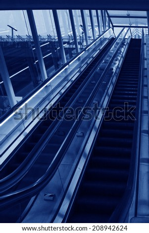running automatic elevator in a shop, closeup of photo