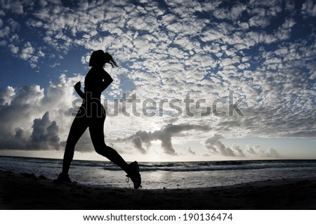 Running Away on the Beach - stock photo