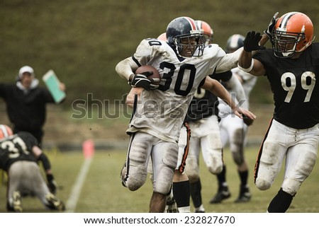 Running Back Carrying Ball - stock photo