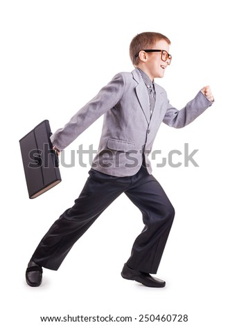 running Boy in a suit isolated on the white - stock photo