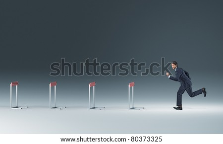running businessman and 3d obstacle - stock photo