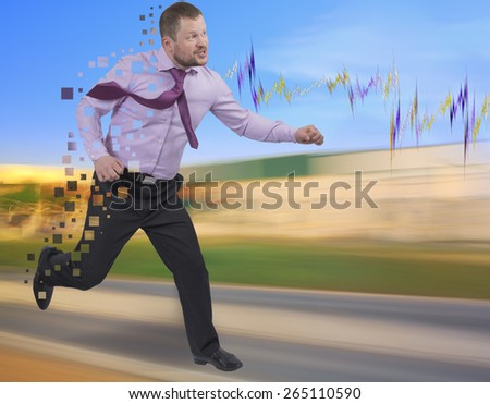 Running businessman in a hurry on blurred background - stock photo