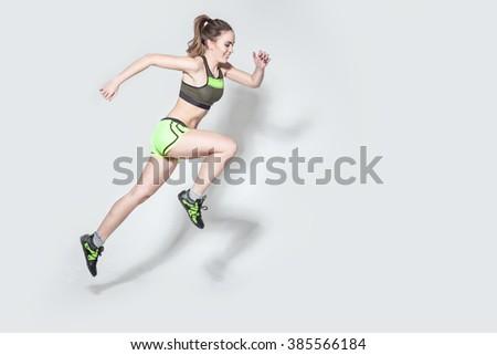 running caucasian woman studio isolated on white - stock photo
