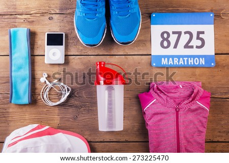 Running composition on wooden background - stock photo