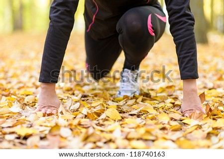 Running concept. Female athlete runner getting ready to run. Caucasian unrecognizable model exercising outdoor.