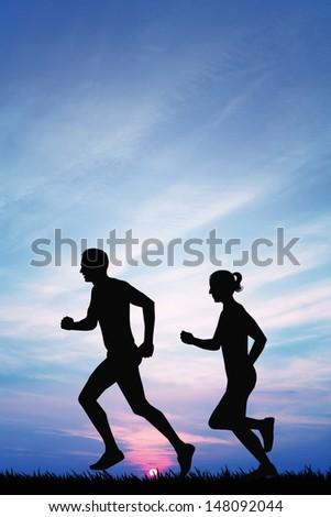 Running couple at sunset - stock photo