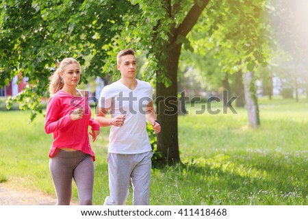 Running couple jogging in the park
