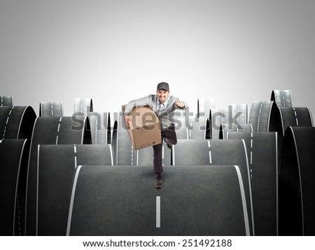 running delivery man and abstract street background - stock photo