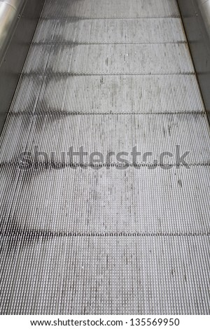 Running escalator bright, modern construction and architecture - stock photo