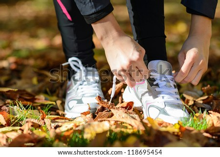 Running exercising sport concept. Tying sport shoes lazes before run. - stock photo