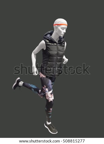 Running female mannequin isolated on gray background. No brand names or copyright objects.