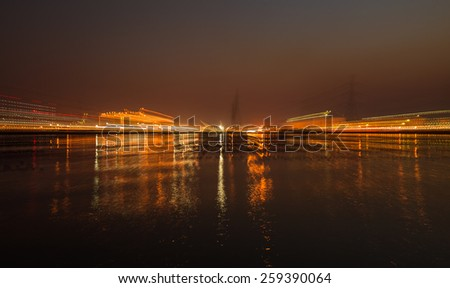 Running focus to industry city in night time - stock photo