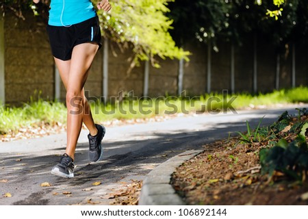 running healthy fitness woman training for marathon outdoors in alleyway. vitality lifestyle exercise athlete. - stock photo