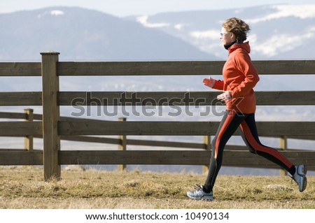 Running in mountain scenery - stock photo