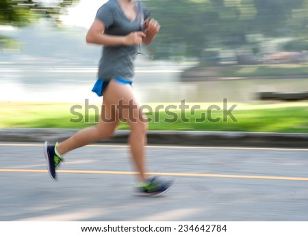running in park, blurred motion abstract background  - stock photo