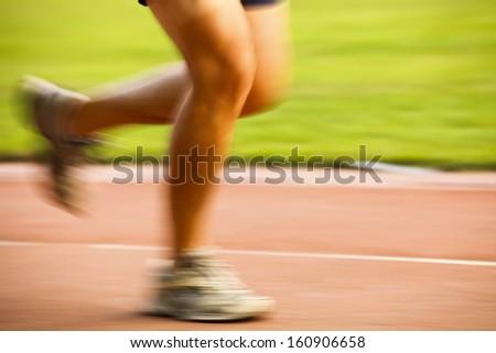running in stadium at sunset - stock photo