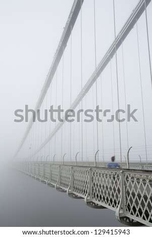 Running into the void - Clifton Suspension bridge in the early morning mist