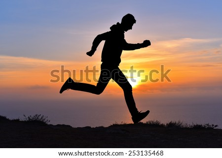 Running jumping man above sunset and mountain. Sport sky sun nature landscape