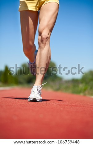 Running legs and shoes of runner in action - stock photo