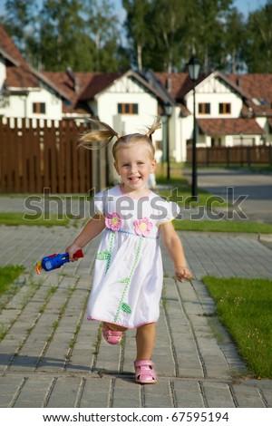 Running little cheerful girl - stock photo