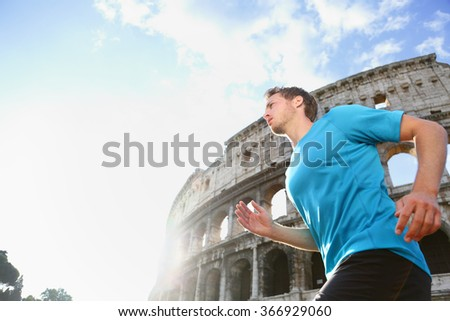Running male runner jogging against Colosseum. Man athlete  on run confident in sportswear. Young man is exercising on sunny day living healthy active lifestyle in Rome, Italy. - stock photo