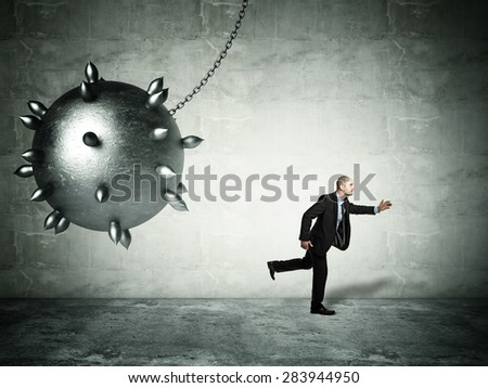 running man and iron ball - stock photo